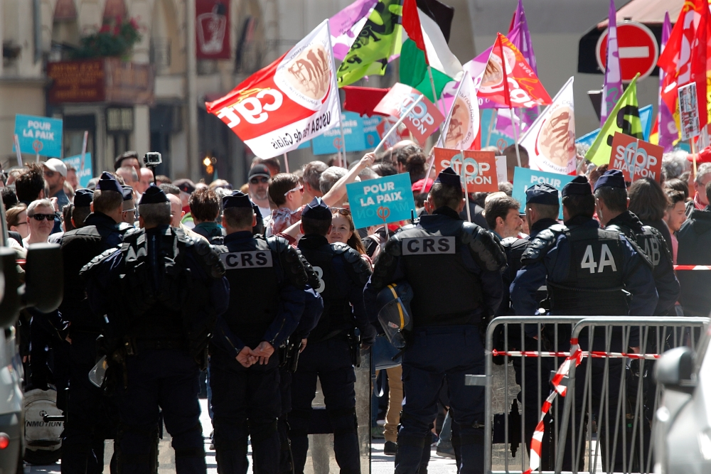 """French riot policemen watch on an anti-Macron """"festive"""" protest called by far-left opposition """"France Insoumise"""" (France Unbowed) political party, two days ahead of the first anniversary of his election as President, in Paris, France, on Saturday. — Reuters"""