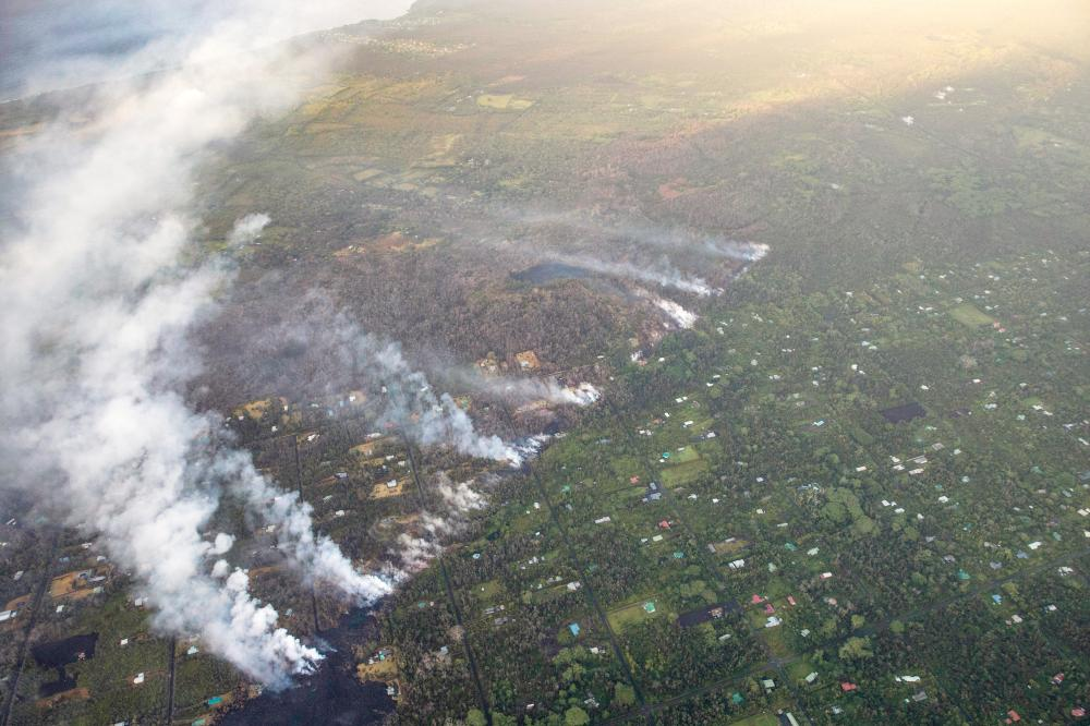 Fissures continue to vent an extraordinary amount of toxic gases, creating hazardous breathing conditions in the immediate and downwind areas, Pahoa, Hawaii, on Saturday. — EPA
