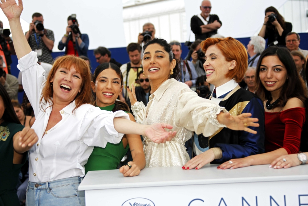 From left, director Eva Husson poses with cast members Evin Ahmad, Emmanuelle Bercot, Golshifteh Farahani and Mari Samidovi during a photocall for their film