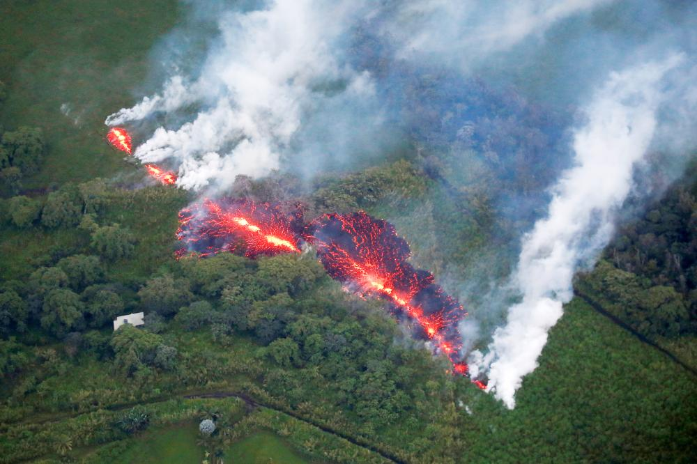 Lava erupts from a fissure east of the Leilani Estates subdivision during ongoing eruptions of the Kilauea Volcano in Hawaii, on Sunday. — Reuters