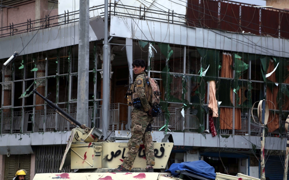 Afghan security officials inspect a scene of militants attack on the finance department building in Jalalabad, Afghanistan, in this May 13, 2018 file photo. — EPA