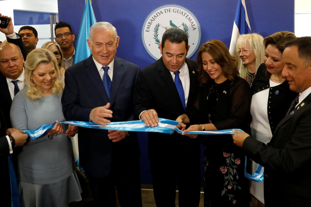 Hilda Patricia Marroquin, the wife of Guatemalan President Jimmy Morales, cuts the ribbon during the dedication ceremony of the embassy of Guatemala in occupied Jerusalem, as she stands with Guatemalan President Jimmy Morales, Israeli Prime Minister Benjamin Netanyahu and his wife Sara, and Guatemalan Foreign Minister Sandra Jovel Polanco, Wednesday. — Reuters