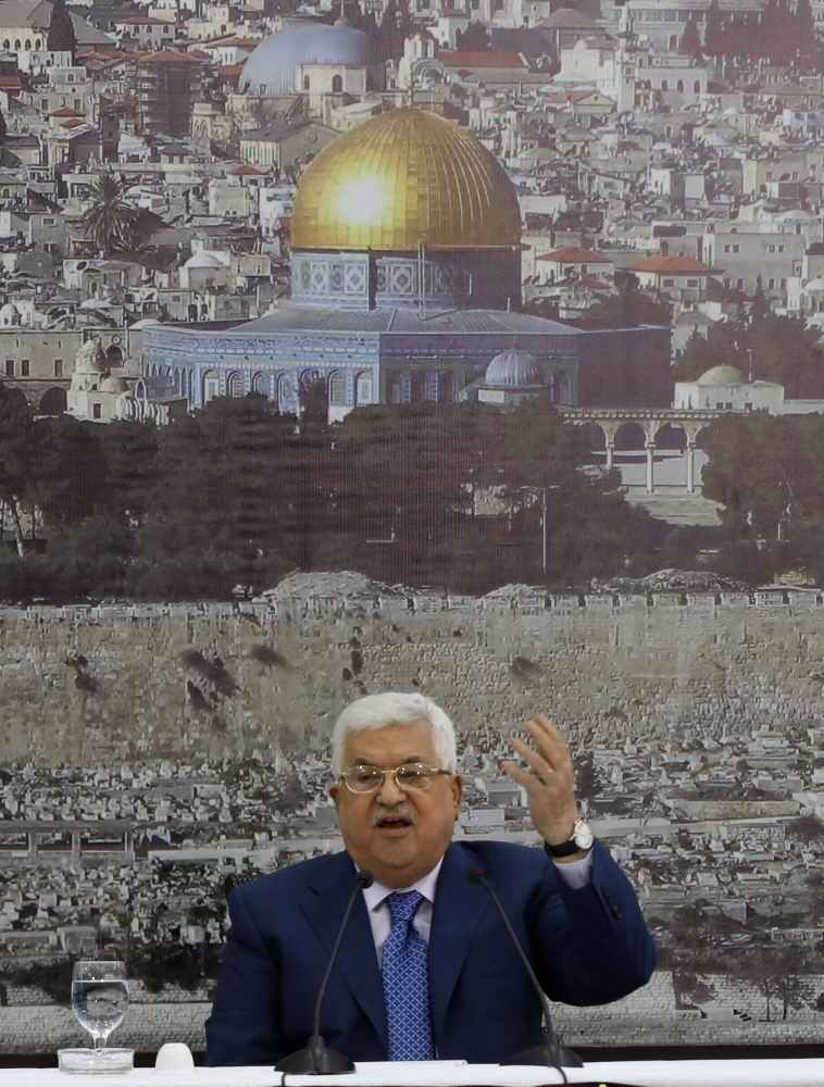 Palestinian President Mahmoud Abbas speaks during a meeting of the Palestine Liberation Organization (PLO) executive committee, at his headquarter in the West Bank town of Ramallah. — EPA