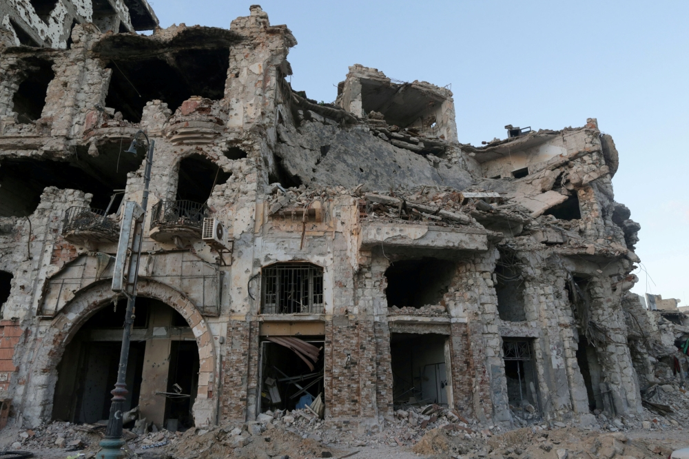 A historic building that was destroyed during a three-year conflict is seen in Benghazi, Libya. — Reuters