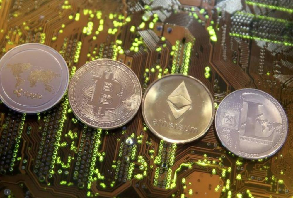File photo shows representations of the Ripple, Bitcoin, Etherum and Litecoin virtual currencies  on a PC motherboard in this illustration picture. – Reuters