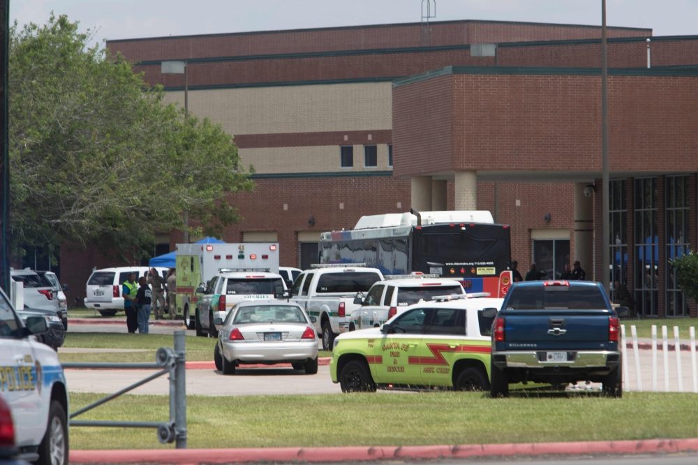 Emergency crews gather in the parking lot of Santa Fe High School where at least eight people were killed on Friday in Santa Fe, Texas. — AFP