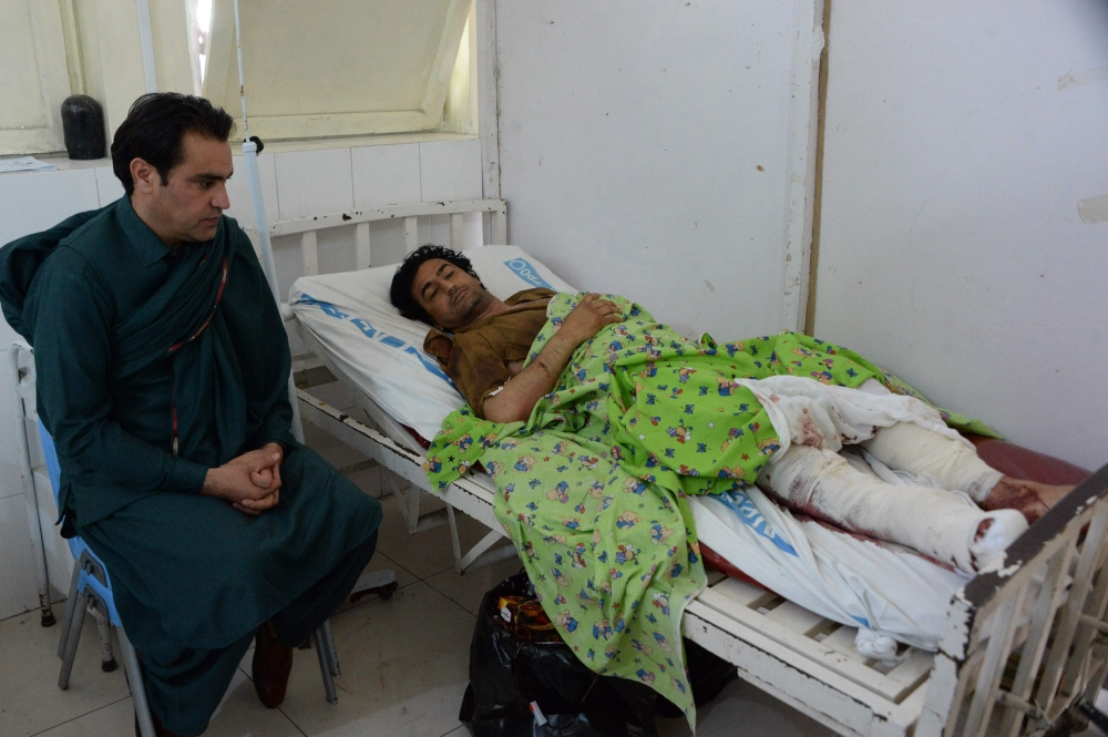 An Afghan victim receives treatment at a hospital following multiple explosions targeted a cricket Stadium in Jalalabad on Saturday. — AFP