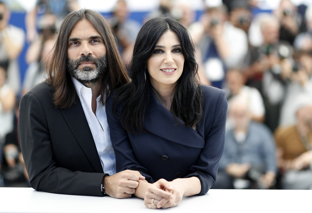 Producer Khaled Mouzanar and director Nadine Labaki pose during the photocall for