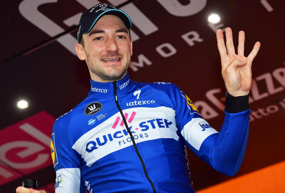 Italian rider Elia Viviani of the Quick-Step Floors team celebrates on the podium after winning the 17th stage of the Giro d'Italia cycling race over 155km from Riva del Garda to Iseo, Italy, Wednesday. — EPA