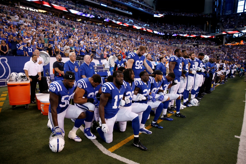 File photo shows Indianapolis Colts players kneeling during the playing of the National Anthem before the game against the Cleveland Browns at Lucas Oil Stadium in Indianapolis, IN, US.— Reuter