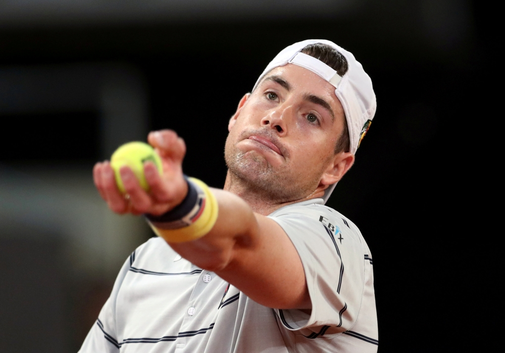 File photo shows John Isner of the US in action during his Madrid Open quarter inal match against Germany's Alexander Zverev. — Reuters