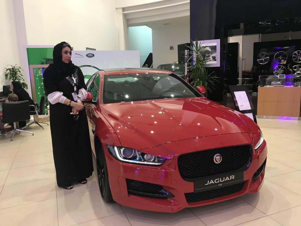 Women staff fill car showrooms