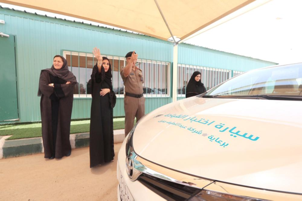 A handout photo made available by Center for International Communication (CIC) of the Saudi Ministry of Information shows a Saudi woman preparing for a driving exam at the General Department of Traffic in Riyadh. Saudi Arabia issued driving licenses to 10 Saudi women on Monday. — EPA