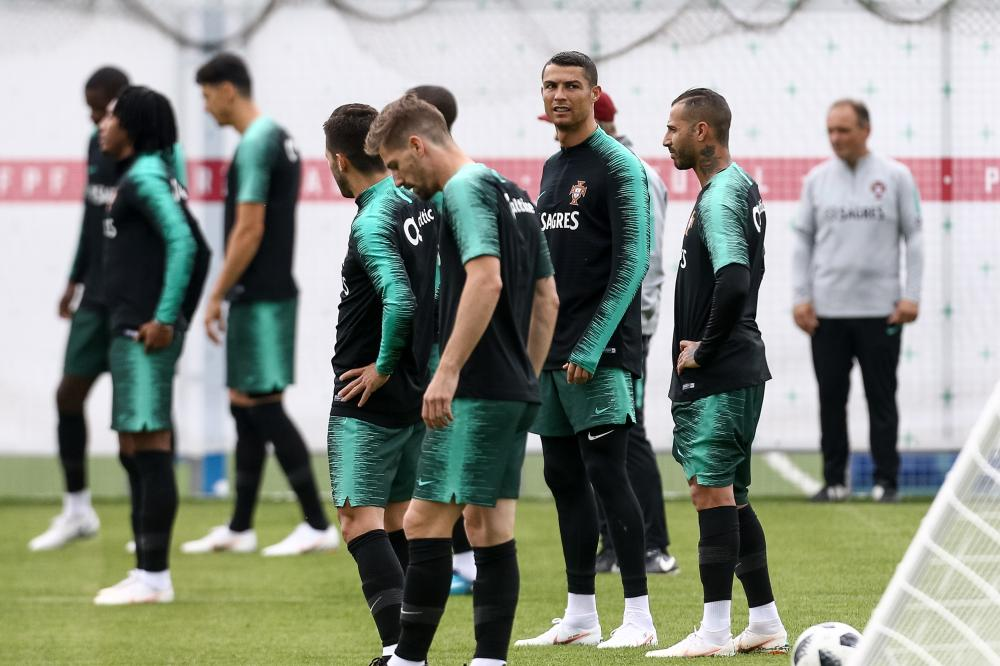 Portugal national team player Cristiano Ronaldo (C facing) and teammates during a training session at the Kratovo training camp in Russia Thursday. — EPA