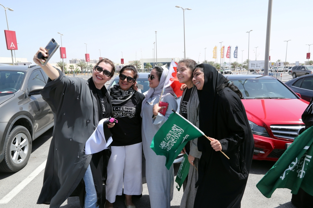 Bahraini and Saudi women celebrate the lifting of the driving ban on women. — Reuters