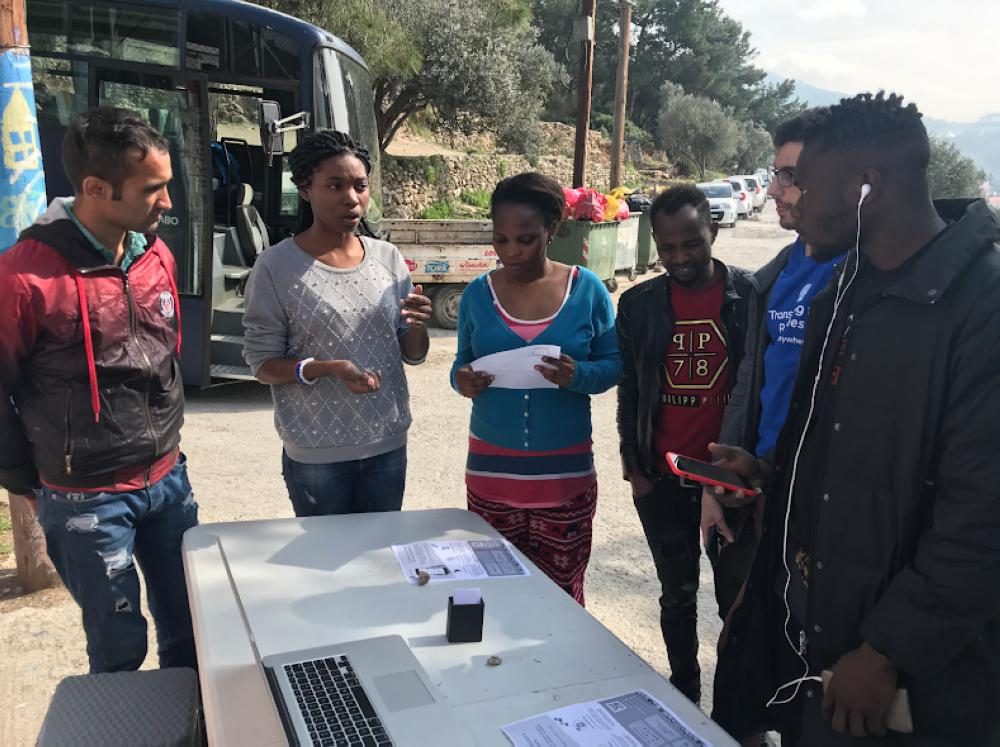 Some camp residents volunteer as in-person translators for organizations and refugees — Samos, Greece