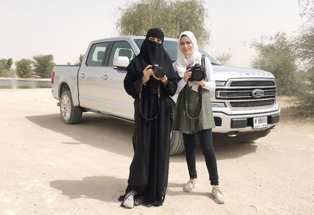 Layan Damanhouri (right), and Nawal Aljabr, another Saudi female journalist from Riyadh newspaper during a test-drive event for 2018 Ford F-150