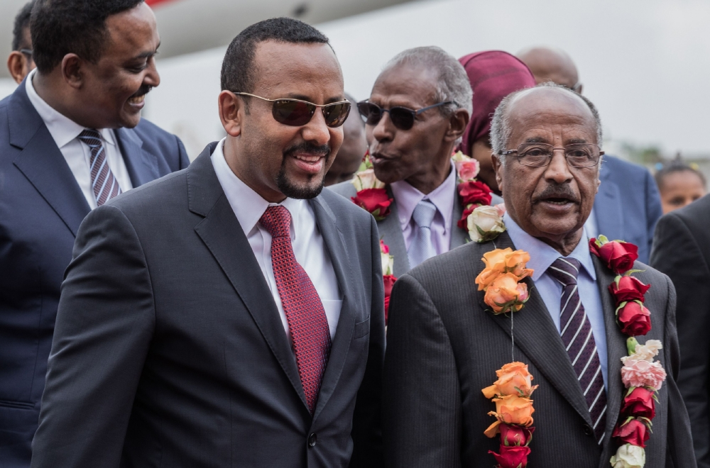 Eritrea's Foreign Minister Osman Saleh Mohammed, right, walks with Ethiopia's Prime Minister Abiy Ahmed, second left, and Ethiopia's Foreign Minister Workeneh Gebeyehu, left, as an Eritrean delegation for peace talks with Ethiopia arrives at the international airport in Addis Ababa in this June 26, 2018 file photo. —A FP
