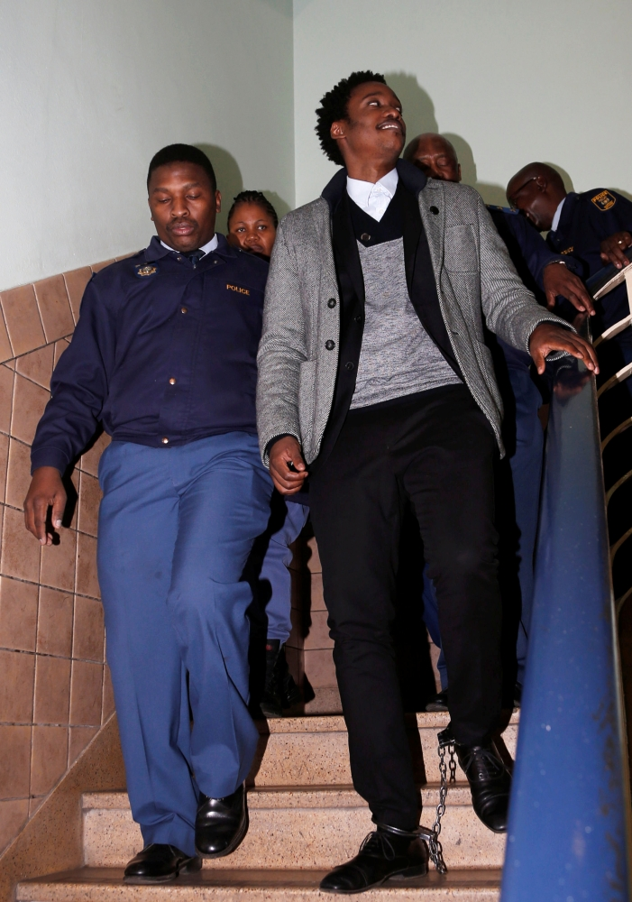 Duduzane Zuma, the son of scandal-plagued former South African President Jacob Zuma, leaves the Johannesburg's Specialized Commercial Crime court, in shackles after appearing on charges of corruption, in Johannesburg, South Africa, on Monday. — Reuters