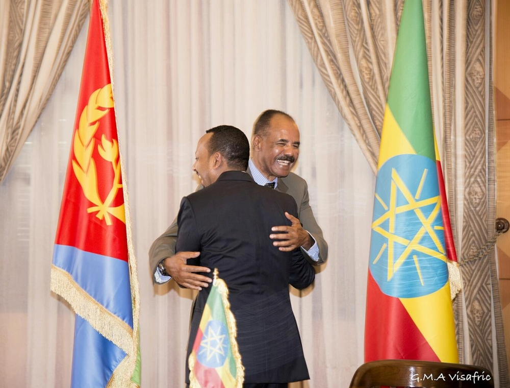 Ethiopia's Prime Minister Abiy Ahmed and Eritrean President Isaias Afwerk embrace at the declaration signing in Asmara, Eritrea, on Monday. — Reuters