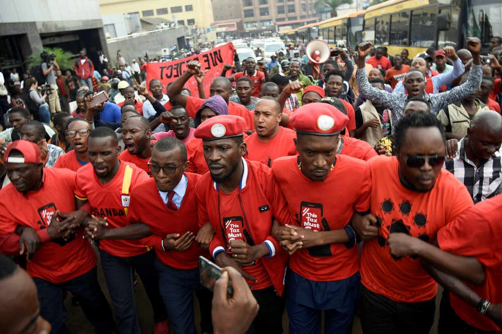 Ugandan musician turned politician, Robert Kyagulanyi, leads activists during a demonstration against new taxes including a levy on access to social media platforms in Kampala, Uganda, on Wednesday. — Reuters