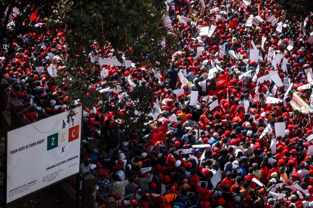 Zimbabwe main opposition party the Movement for Democratic Change (MDC) Alliance supporters lead by Nelson Chamisa march for electoral reforms to the Zimbabwe Electoral Commission (ZEC) in the streets of the capital Harare on Wednesday. — AFP