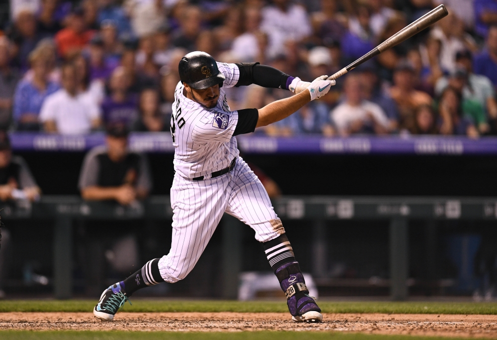 Colorado Rockies third baseman Nolan Arenado (28) RBI singles in the fourth inning against the Arizona Diamondbacks at Coors Field. — Reuters