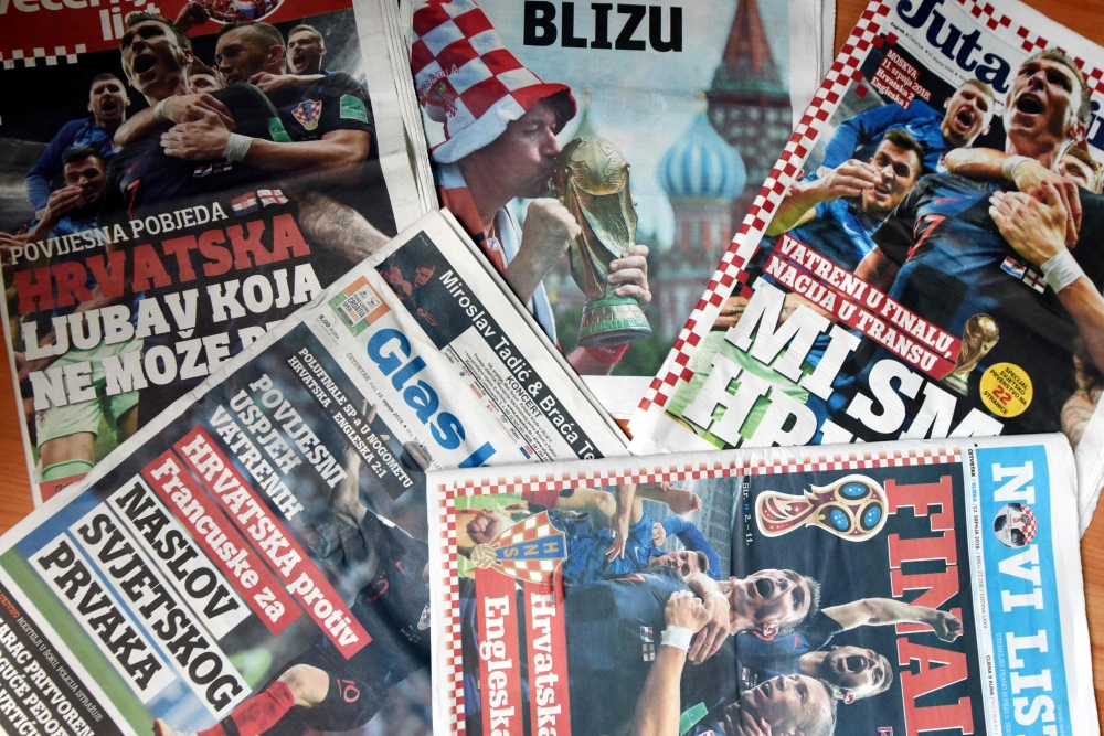 A picture shows frontpages of Croatian daily newspapers in Zagreb on July 12, 2018 a day after the 2018 FIFA World Cup Russia semi final football match between Croatia and England. / AFP / STR