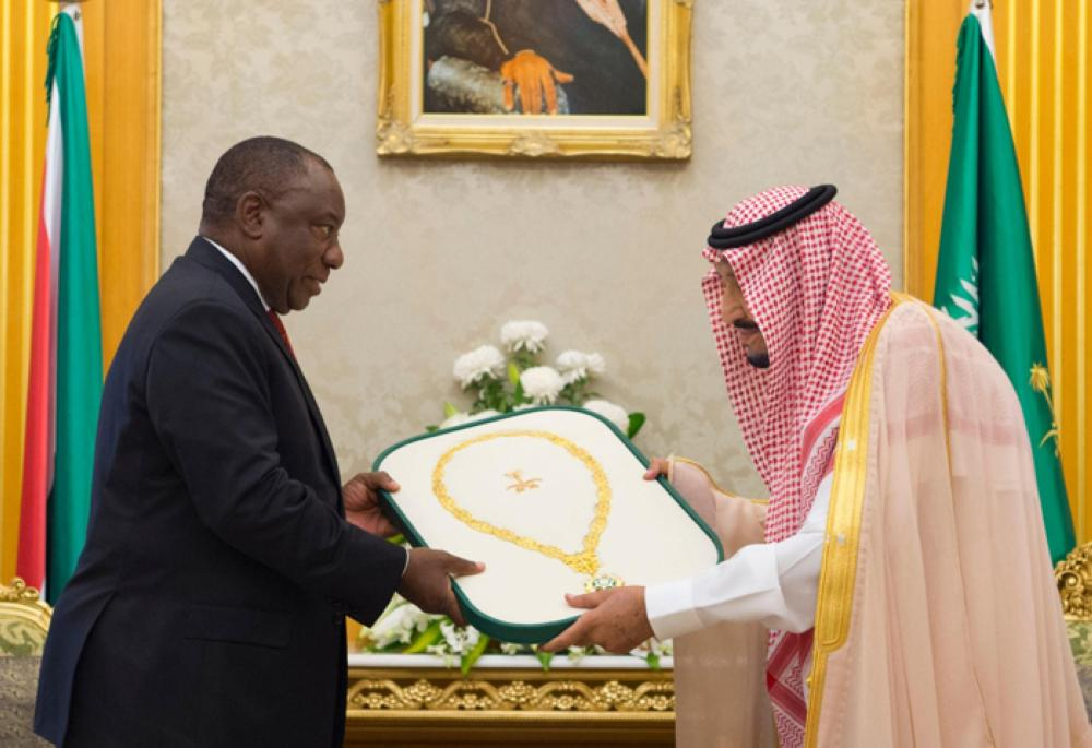 Custodian of the Two Holy Mosques King Salman presents the Collar of King Abdulaziz to South African President Cyril Ramaphosa during their meeting at Al-Salam Palace in Jeddah on Thursday. — SPA