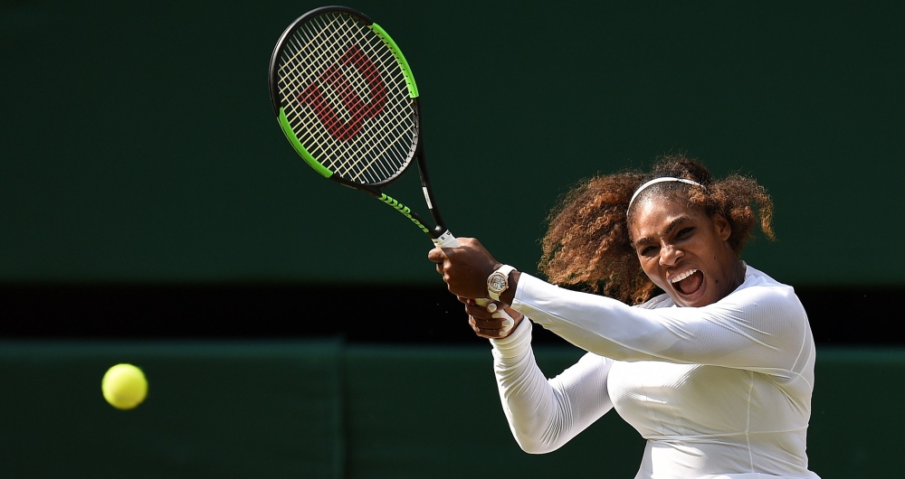 US player Serena Williams returns against Germany's Julia Goerges during their women's singles semifinal match on the tenth day of the 2018 Wimbledon Championships at The All England Lawn Tennis Club in Wimbledon, southwest London, on Thursday. — AFP