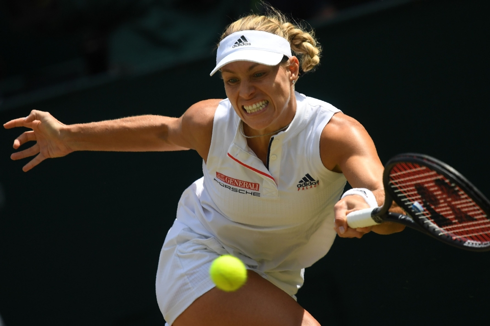 Germany's Angelique Kerber returns against Latvia's Jelena Ostapenko during their women's singles semifinal match on the tenth day of the 2018 Wimbledon Championships at The All England Lawn Tennis Club in Wimbledon, southwest London, on Thursday. — AFP