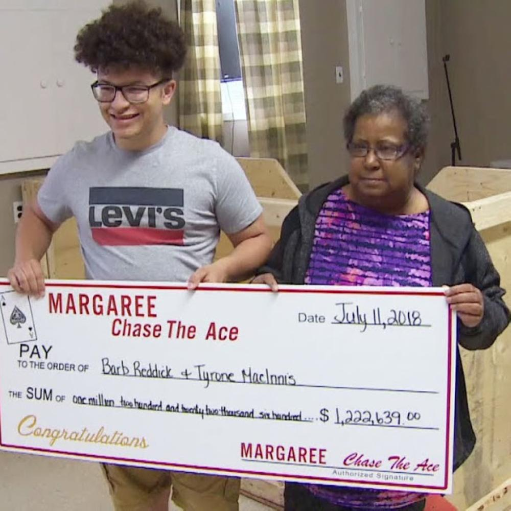 Barbara Reddick and her nephew Tyrone MacInnis pose with their winning lottery ticket in Margaree Forks, Canada on Friday.