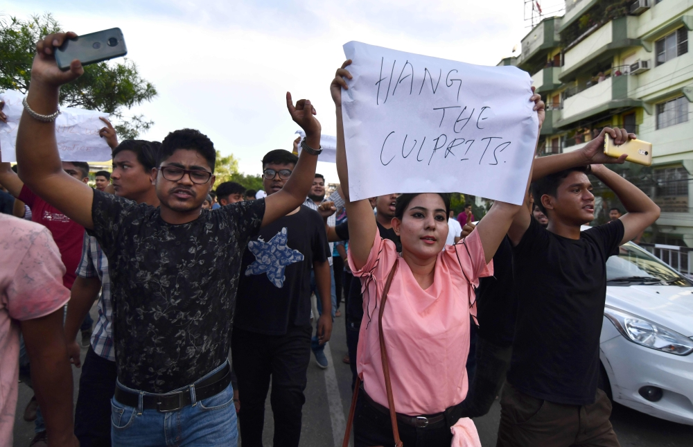 Indian protesters demand arrest of people involved in the killing of two men in Karbi Anglong district, during a protest in Guwahati, the capital city of India's northeastern state of Assam, in this June 10, 2018 file photo. — AFP