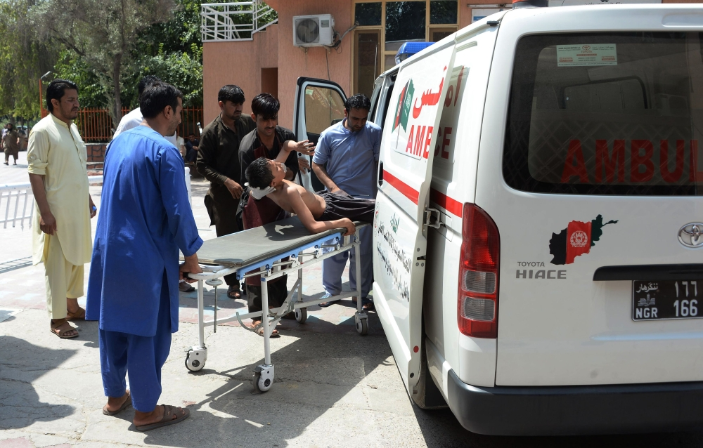 Afghan volunteers carry an injured youth on a stretcher to a hospital following an attack that targeted an education department compound in Jalalabad, Afghanistan, in this July 11, 2018 file photo.  — AFP