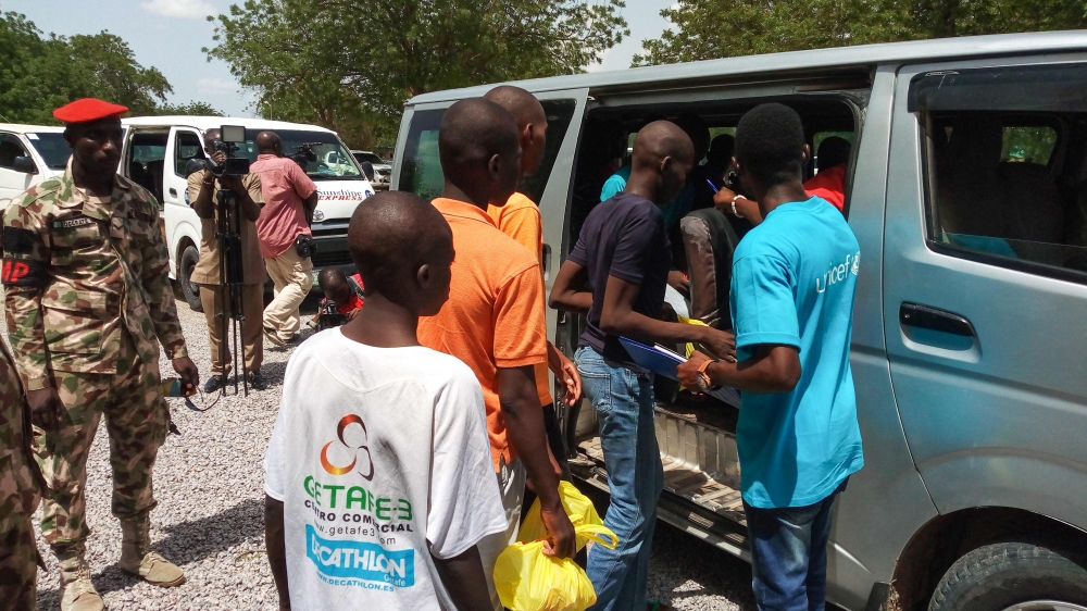 Children, aged between seven and 18, cleared of ties with Boko Haram, get on a car being escorted by military personnel in Maiduguri, Nigeria, in this July 9, 2018 file photo. — AFP