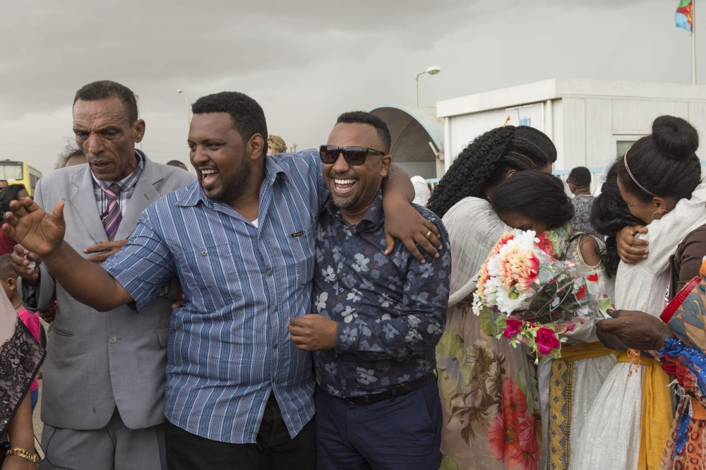 Long-separated families are reunited on the tarmac at the Asmara International airport, Wednesday, upon the arrival of the first flight from Ethiopian capital Addis Ababa in twenty years. — AFP