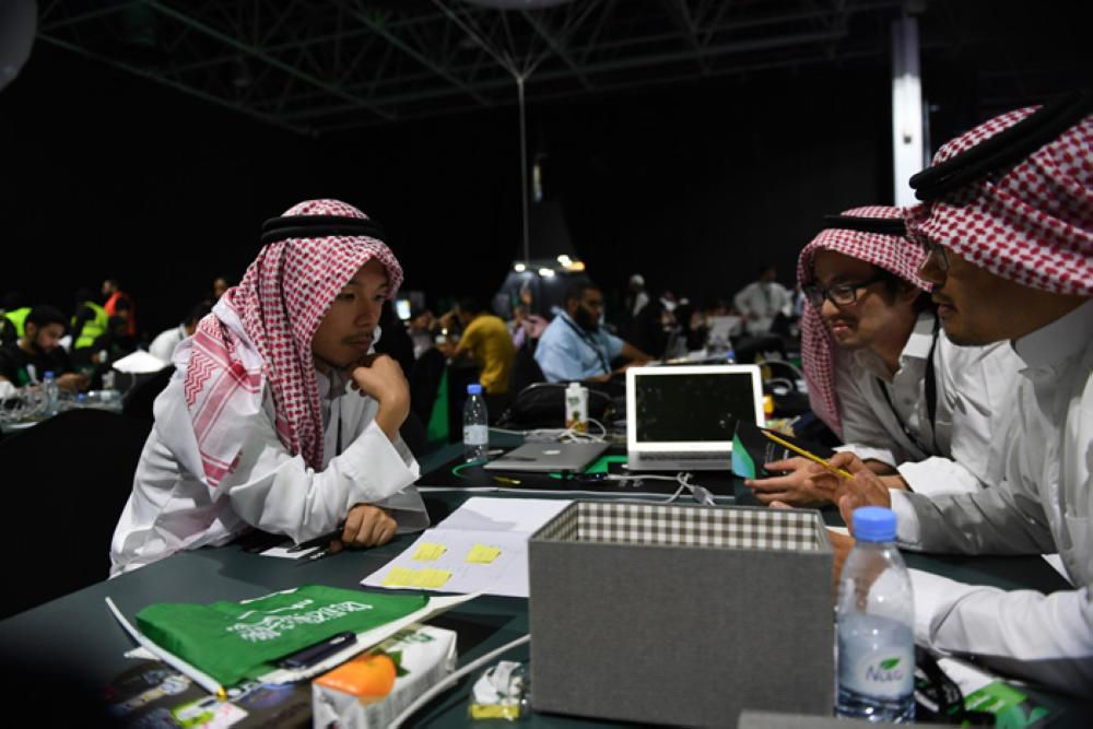 The Japanese team in the traditional Saudi dress during the Hajj Hackathon in Jeddah. — Courtesy photos