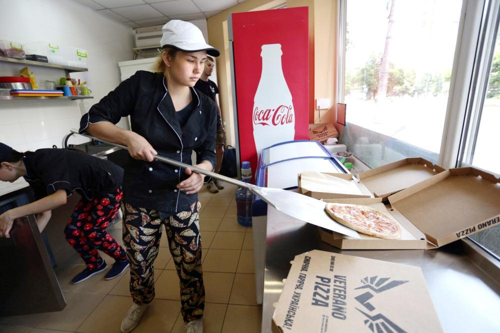 An employee of pizzeria