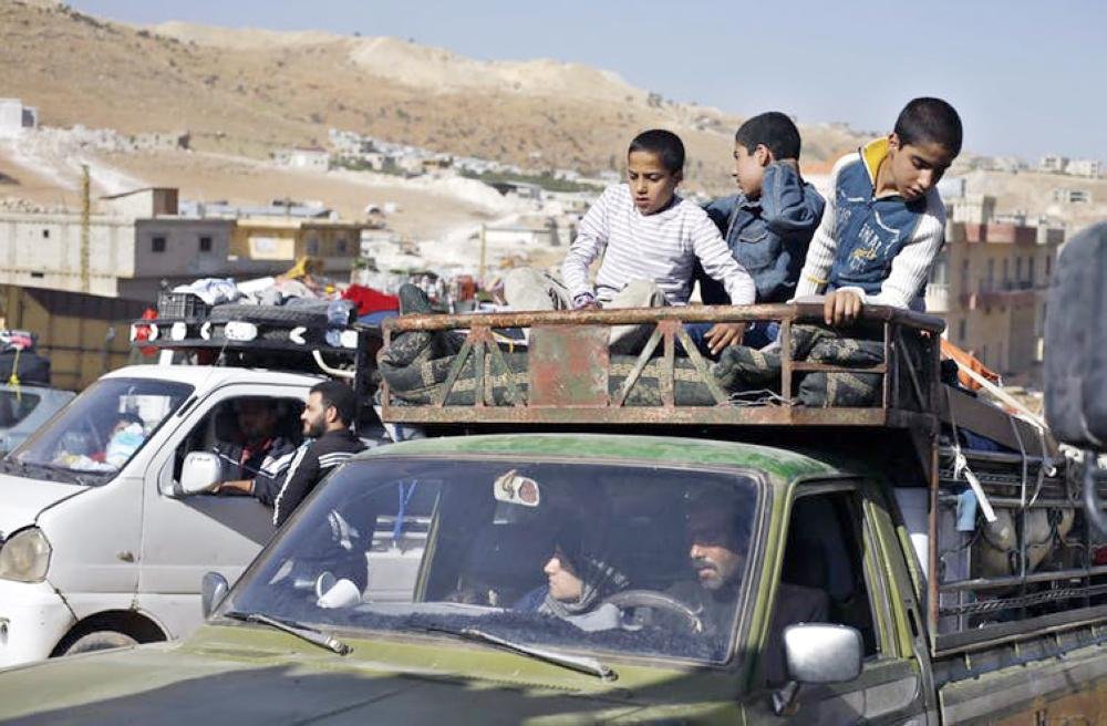 Syrian refugees get ready to cross back home into war-torn Syria from the eastern Lebanese border town of Arsal. — Courtesy photo