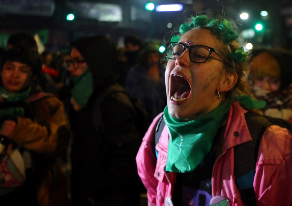 A woman reacts outside the Congress after senators rejected a bill to legalize abortion, in Buenos Aires, Argentina, on Thursday. — Reuters