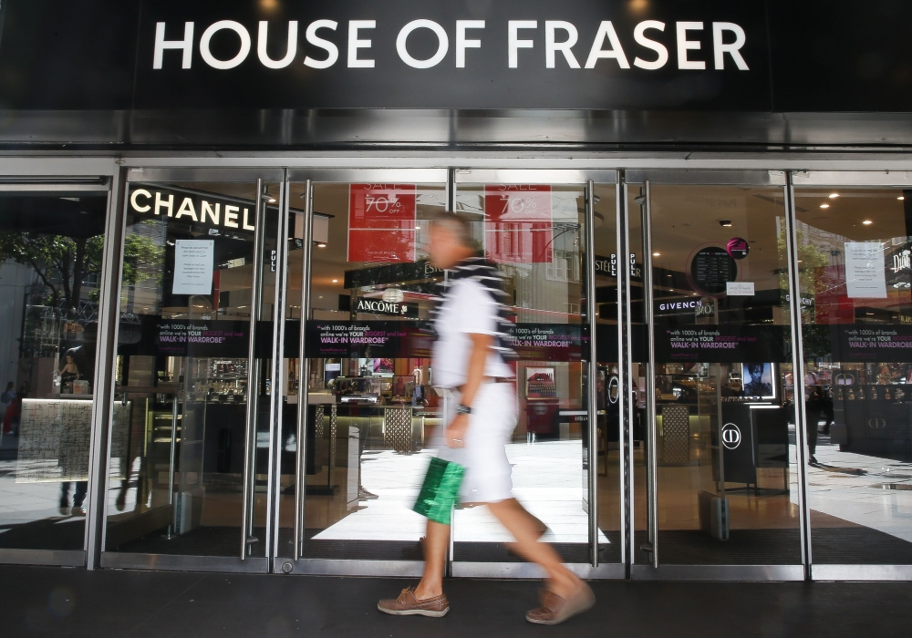 A man walks past the entrance of the retail store House of Fraser in central London on Friday.  House of Fraser, the Chinese-owned UK department store chain, entered administration on August 10 only to be swiftly snapped up by retailer Sports Direct for £90 million ($115 million, 100 million euros). — AFP