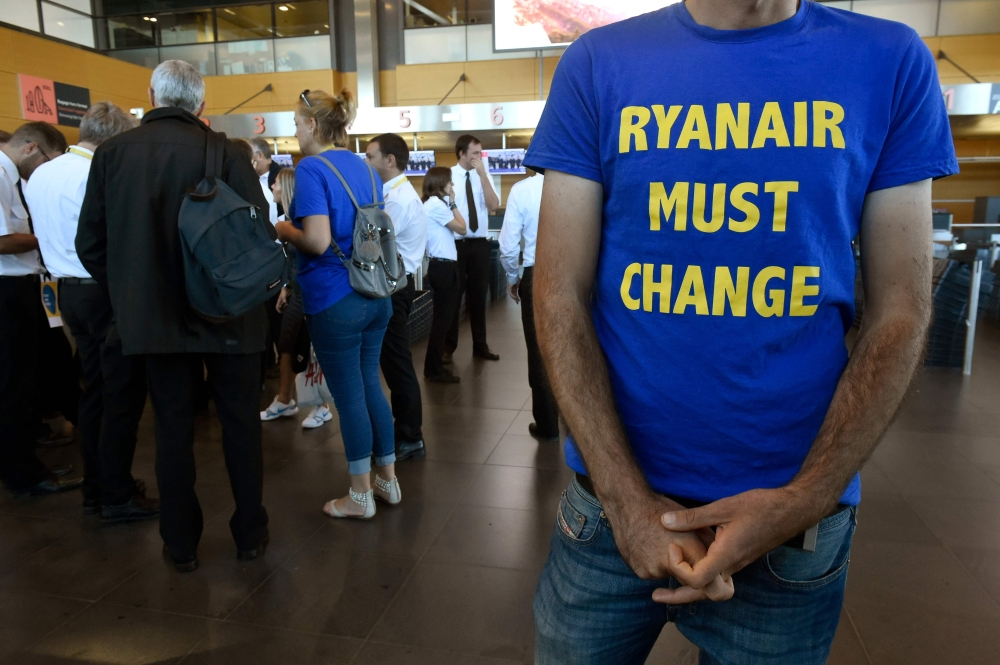 Belgium-based Ryanair pilots gather at Charleroi Airport in Gosselies on Friday as they take part in a European wide strike. Ryanair is bracing for mass travel disruptions as pilots across Europe begin a coordinated 24-hour strike to push their demands for better pay and conditions at the peak of the busy summer season. — AFP