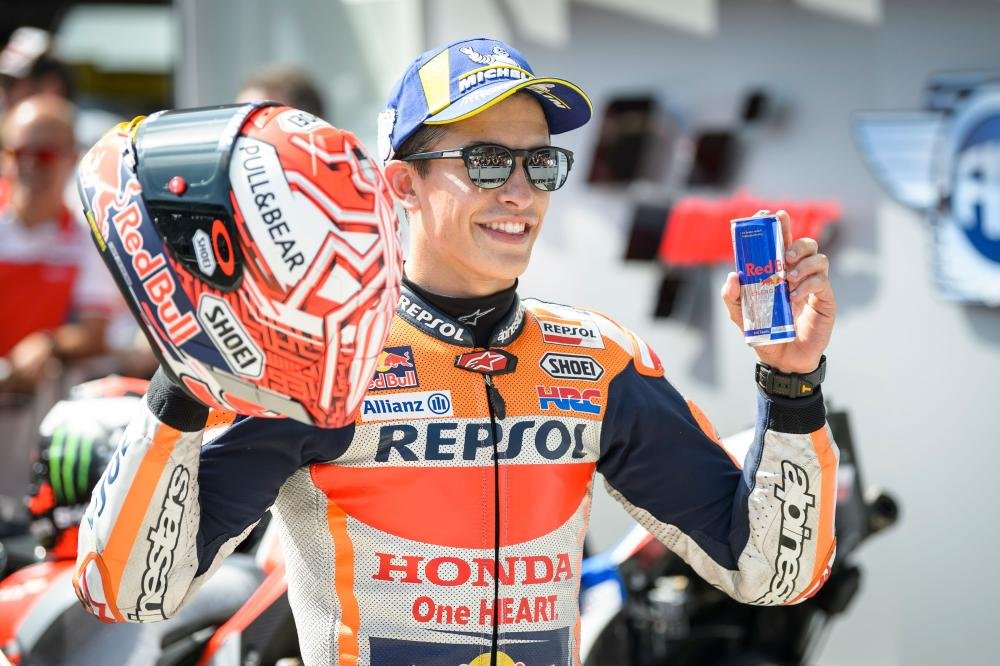 Repsol Honda Team's Spanish rider Marc Marquez celebrates after winning the pole position during the qualifying session of the Austrian MotoGP Grand Prix at the Red Bull Ring in Spielberg, Austria, Saturday. — AFP