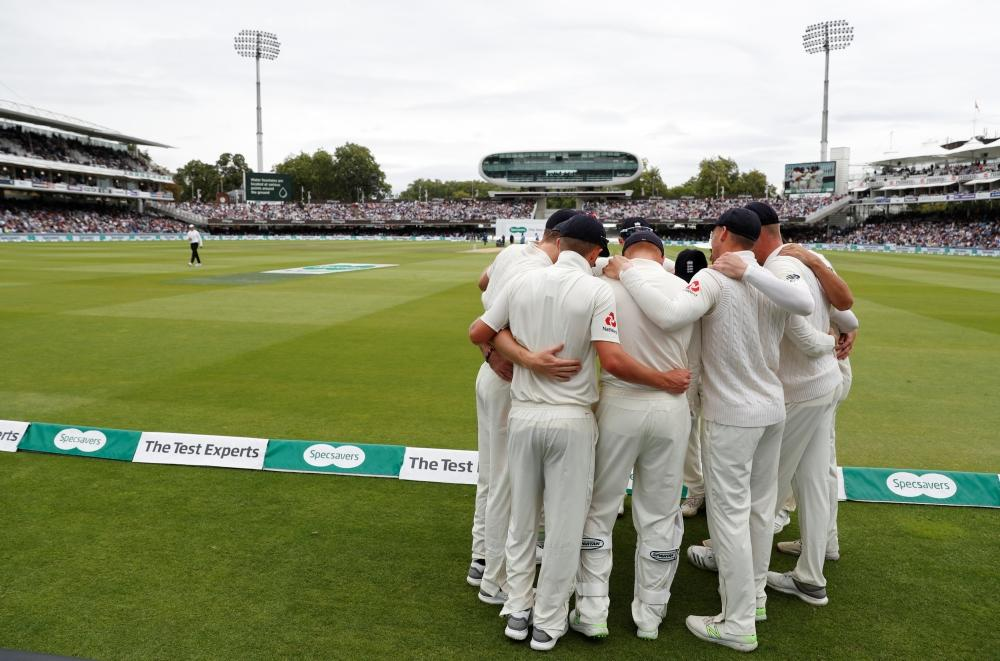 England players huddle together before India's second innings. — Reuters