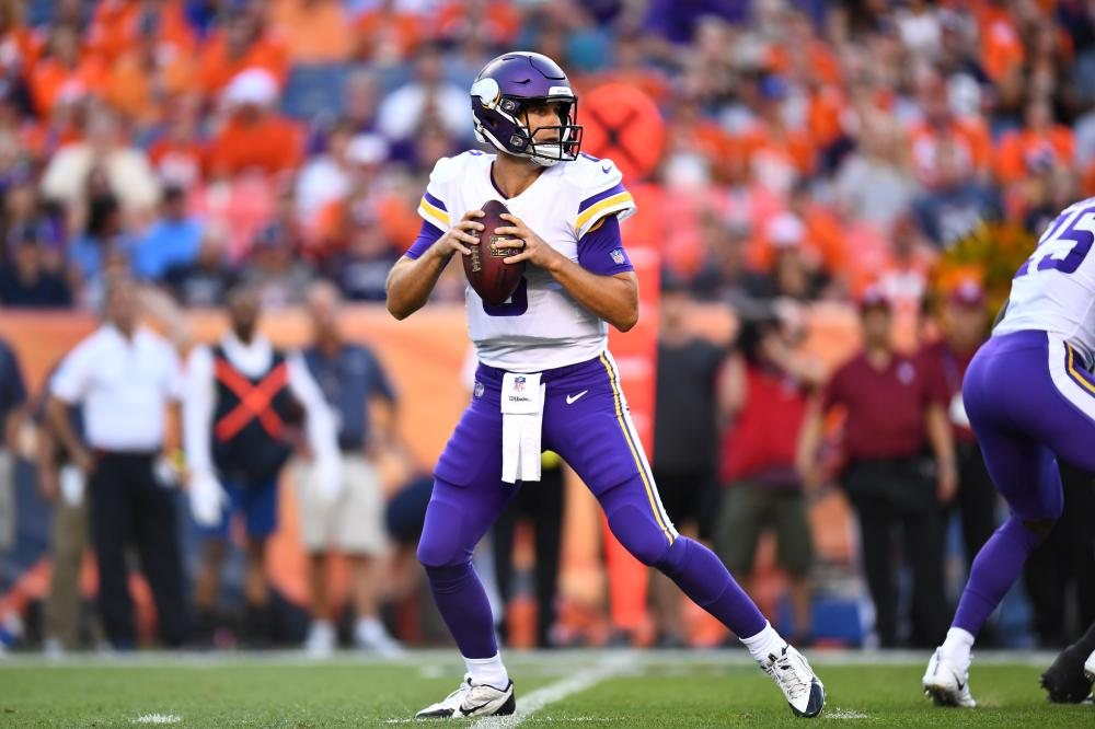 Minnesota Vikings' quarterback Kirk Cousins drops back to pass the ball against the Denver Broncos at Broncos Stadium at Mile High in Denver Saturday. — Reuters