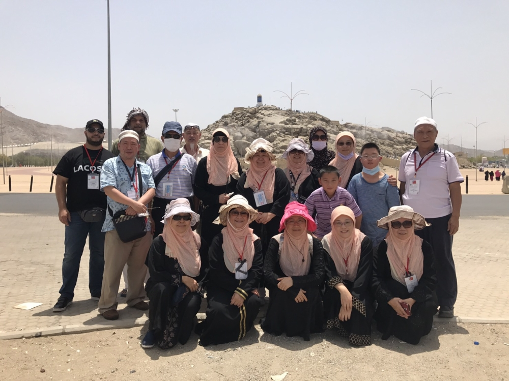 Taiwanese pilgrims stand in front of the Jabal Al-Rahma in Arafat. — Courtesy photo