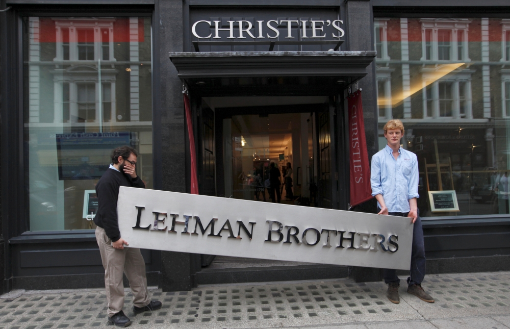 File photo shows a Christie's employees posing with a Lehman Brothers sign at Christie's in central London. — Reuters