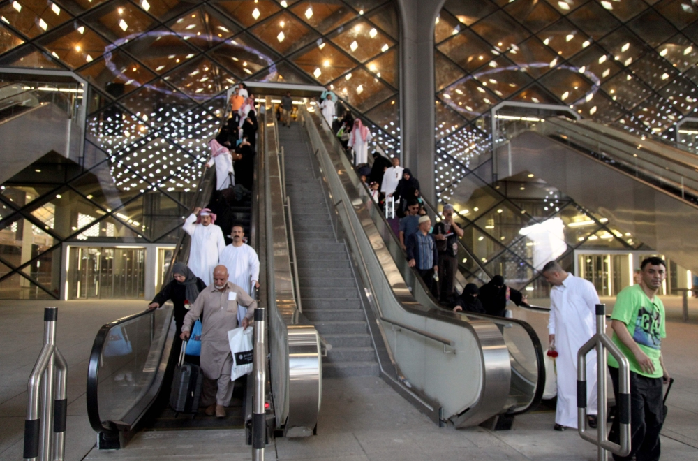 Passengers walk at Makkah's train station on Thursday as the new high-speed railway line linking the two holy cities opens. — AFP