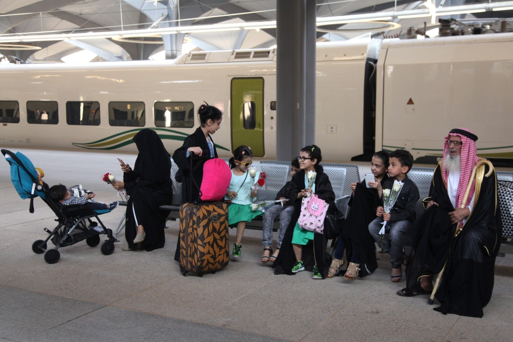 Passengers sit at the platform at Makkah's train station on Thursday as the new high-speed railway line linking the two holy cities opens. — AFP