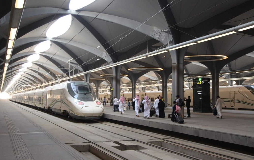 Passengers walk at the platform at Makkah's train station on Thursday as the new high-speed railway line linking the two holy cities opens. — AFP